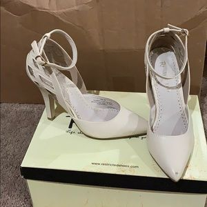 Cream colored heel with straps